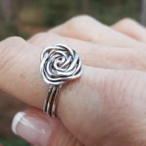 Sterling Silver Wire Wrapped Rose Ring sitting on the fore finger of right hand