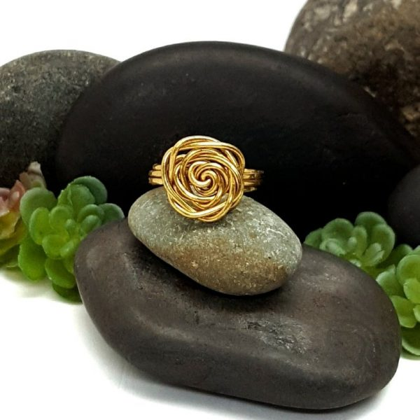 Brass Rose Ring on Rocks