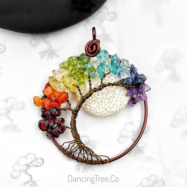 Rainbow curved tree with gemstones making the rainbow color and a white lava stone as moon in back of tree
