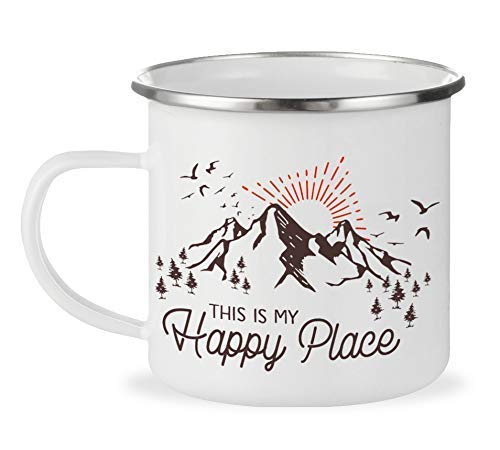 White enamel mug with mountains and the words this is my happy place