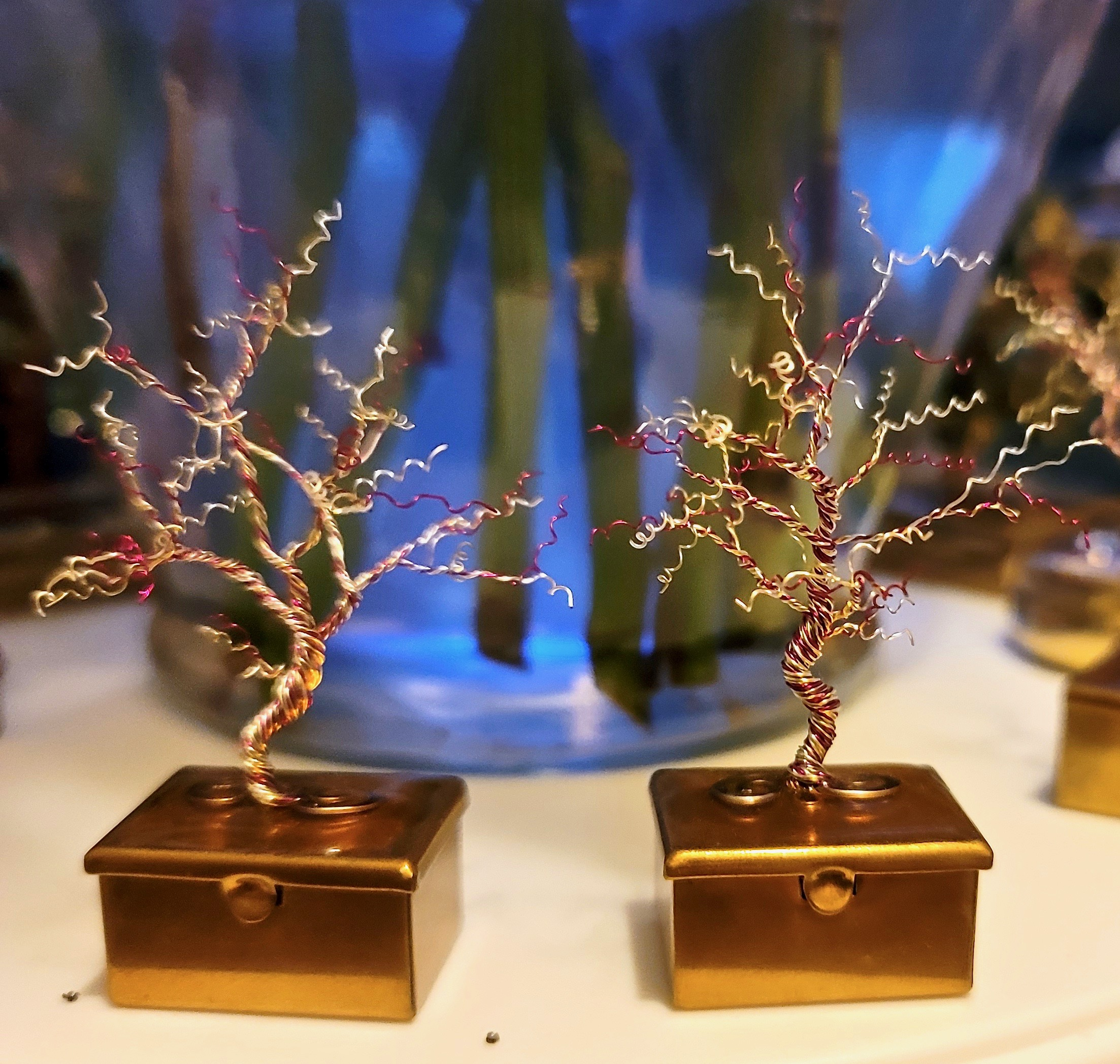 Pink and white miniature dancing tree on metal box