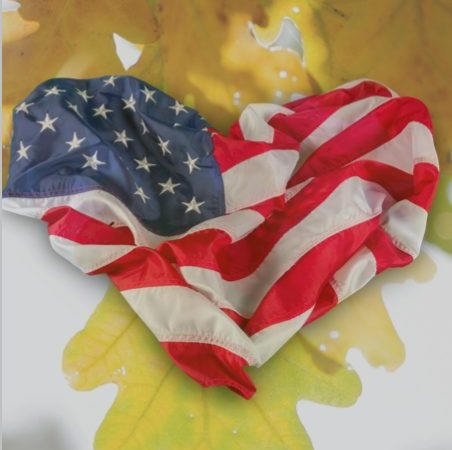 Oak leaf and flag in heart shape representing valor and strength
