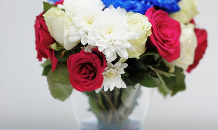Red, white, blue bouquet in clear vase